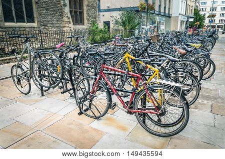CAMBRIDGE UK - AUGUST 11 2015: Parking for Bicycles in Cambridge with steel bars to lock bikes to. Cambridge is a university city and one of the top five universities in the world.