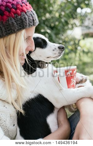 Woman and her puppy drinking together