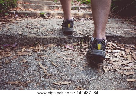 Vintage tone of Hiking boots in outdoor action