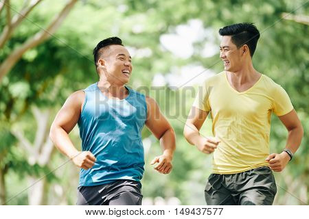Vietnamese young people enjoying jogging in the park