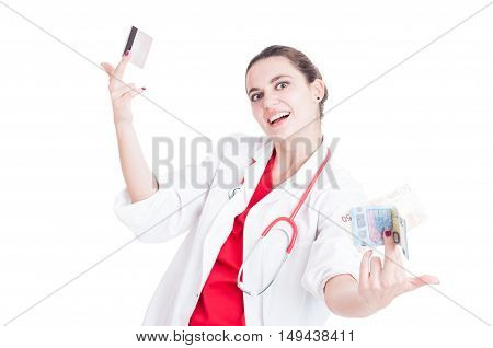 Cheerful Medic Holding Money And Credit Card