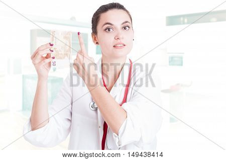 Young Woman Doctor With Euro Money