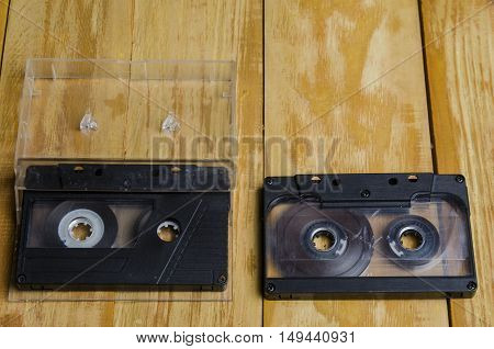 The Cartridge For The Tape Recorder On A Wooden Table