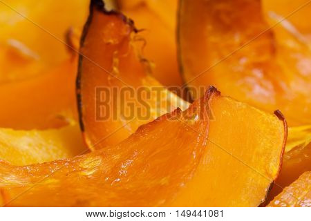 Vivid orange colour slices of baked pumpkin with a honey, hot dessert in autumn