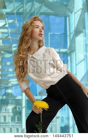 Girl Posing With A Yellow Flower