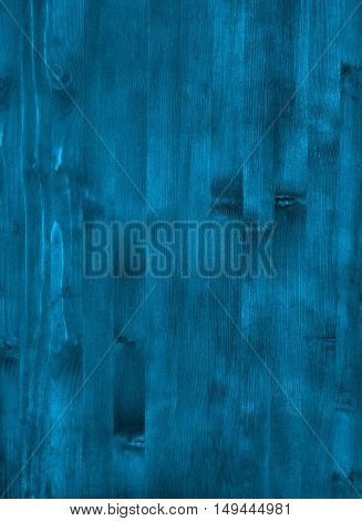 A blue wooden wall with vertical planks. Close up of an old wooden fence panels