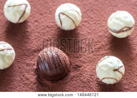Chocolate Candies On Cocoa Background