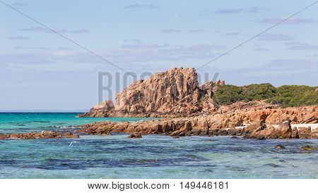 Castle Rock near Dunsborough in Western Australia is a massive chunk of orange granite standing tall at the end of beautiful Castle Bay.