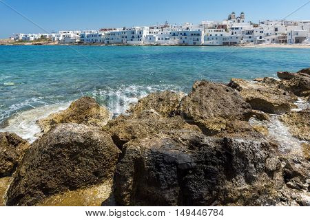 flowers and white houses in town of Mykonos, Cyclades Islands, Greece