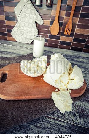 cheese and milk on a wooden board