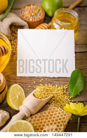 Beekeeping Products With Lemons On A Wooden Table With Empty Card For You Text . Side View
