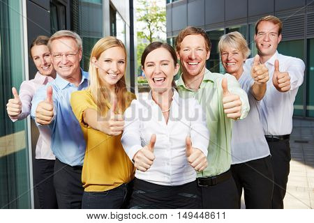Winning and cheering business people team holding many thumbs up