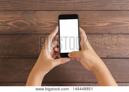 phone in woman hand showing white screen on wood table mockup new phone style jet black color