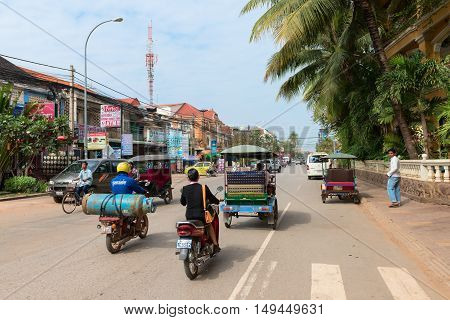 Unsafe Road Traffic With Gas Bottle On Cambodian Street