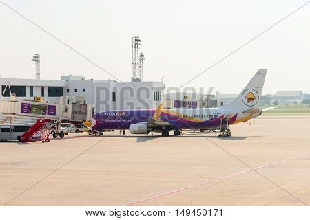 Nok Air Passenger Plane Being Serviced At The Departure Gates Of Don Mueang International Airport.