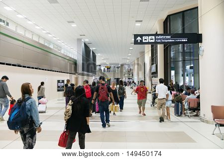 Travellers Stroll Through The Main Concourse Of The Passenger Terminal At Don Mueang International A
