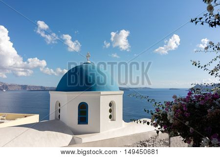 The typical blue dome of the churches in Santorini (Greece)