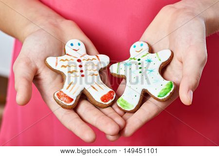 Two Christmas Gingerbread Man Cookies In Hands