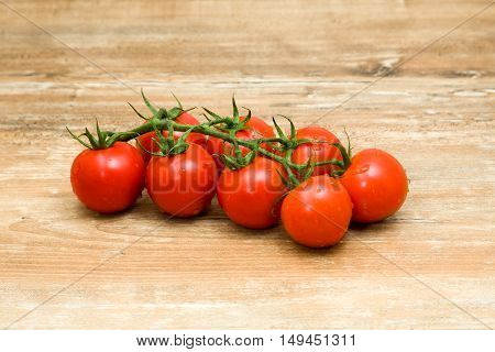 Fresh Cherry tomatoes on old wooden background