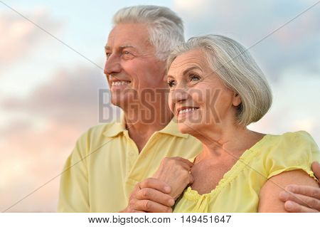 beautiful elderly couple  on the background of sky