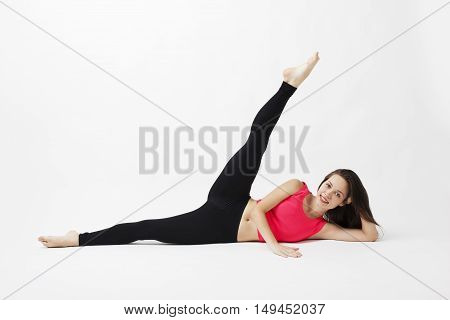 Attractive young woman working in a closed room. Beautiful model, doing exercises. Pilates