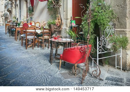 SYRACUSY, SICILY, ITALY - JUNE 26, 2016:Outdoor restaurant in old european town, Siracusa, Sicily