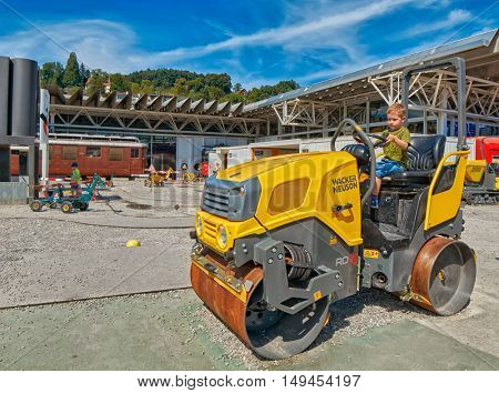 LUZERN, SWITZERLAND - 10 August 2016: Child boy enjoying construction site playground in Swiss museum of transport
