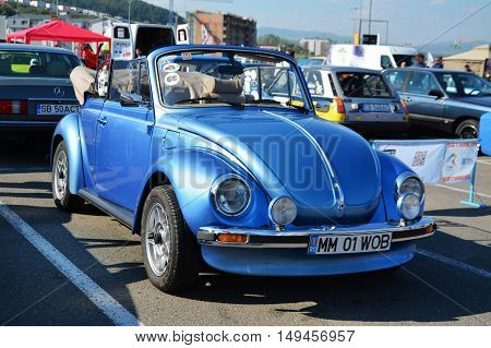 CLUJ-NAPOCA ROMANIA - SEPTEMBER 24 2016: Volkswagen beetle Cabriolet 1303 convertible in the car park
