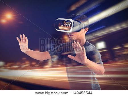 Double exposure. Afro-Amrican boy wearing virtual reality glasses and city nightlife background. Modern technology concept.