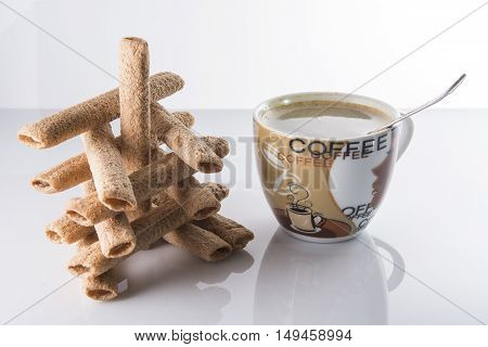 delicious cookies, candies and coffee for breakfast on a light background