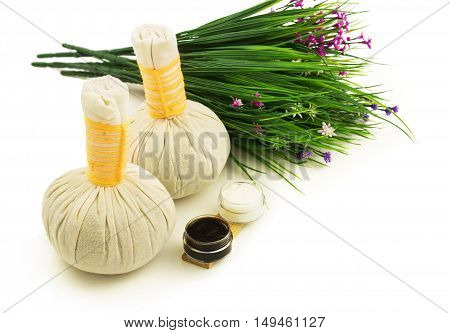 Textile massage spa compress balls with flowers isolated on white background