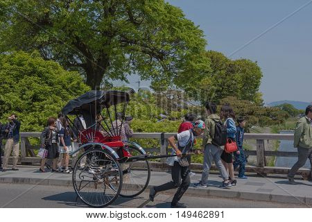 KYOTO, JAPAN - APRIL 30 , 2016: rickshaw  in Arashiyama, Kyoto, Japan. Arashiyama  , Scenic Beauty and Historic  Site. soft focus .  Kyoto, Japan. APRIL 29 2016.