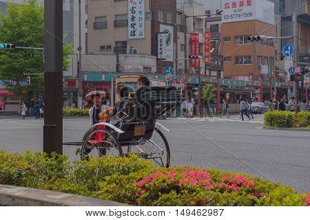 TOKYO  , JAPAN - MAY 2 , 2016 :  Japanese Rickshaw in the road  at asakusa Tokyo Japan .soft focus .   , Tokyo, Japan. MAY 2 2016.