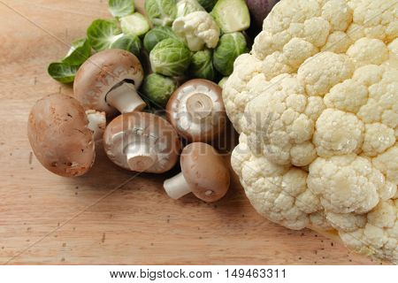 Cauliflower mushrooms and brussels sprouts - fresh healthy vegetables for cooking
