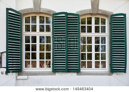 ZONS, GERMANY - SEPTEMBER 25, 2016: Tourists take pictures of old window -