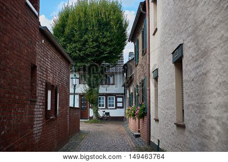 ZONS, GERMANY - SEPTEMBER 25, 2016: Narrow alley ends at a medieval House
