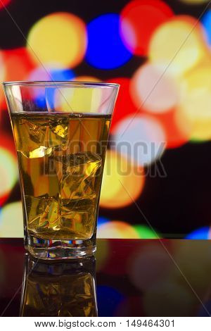 The Refreshing Juice With Ice On A Bright Background