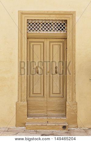 Old rustic wall with wooden textured door