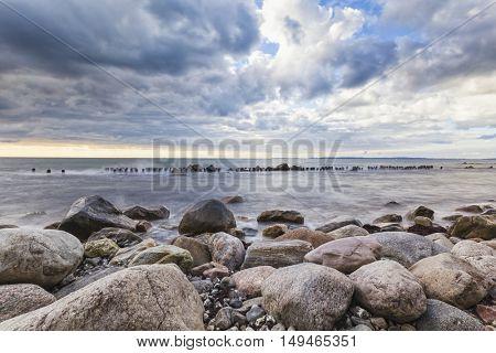 Long exposure shot of a groyne at the coast of Ruegen, Germany