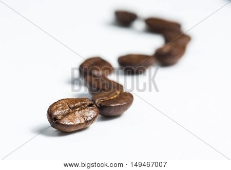 Coffee beans on white background. Closeup, horizontal view