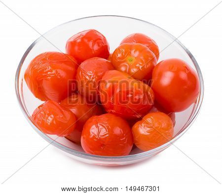 Tomatoes marinated in a plate isolate a