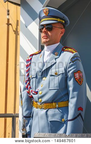 Prague Czech Republic August 20 2011: Guard stands in front of the entrance to the Prague Castle seat of president