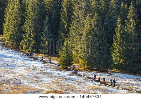 Tatra Mountains, Poland - January 30, 2016: Tourists Strolling On A Sunny Day  In Tatra Mountains, P