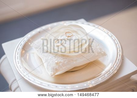 wedding details of a ring on a white substrate