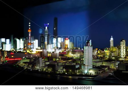 Miniature of modern city with illuminated skyscrapers at night