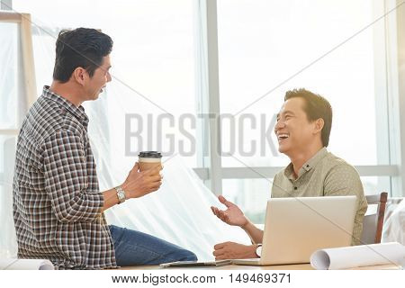 Business people talking and laughing during coffee break