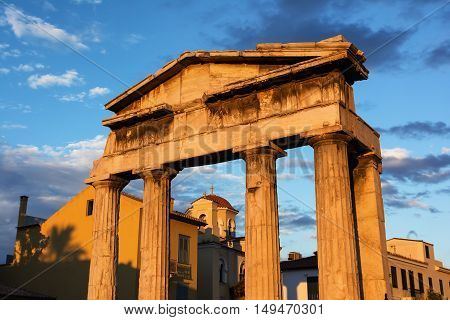 Temple ruins with marble columns at sunset in Athens Greece