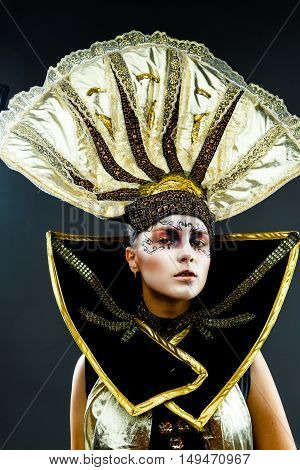 Close up portrait of Beautiful Golden Venetian Carnival Masked woman,sun costume