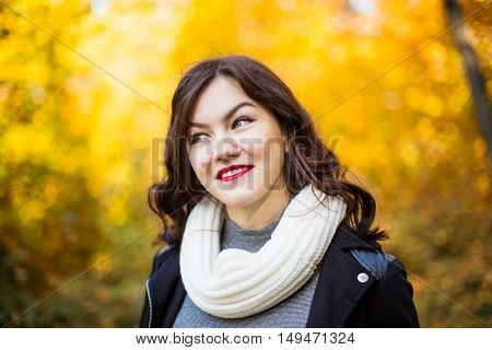 portrait of a girl close-up on a background of the autumn landscape