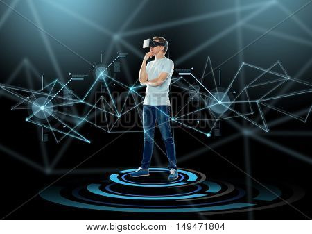 3d technology, virtual reality, entertainment, cyberspace and people concept - happy young man with virtual reality headset or 3d glasses thinking over and projection and dark background